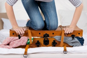 Young-Woman-Packing-Suitcase-1024x683