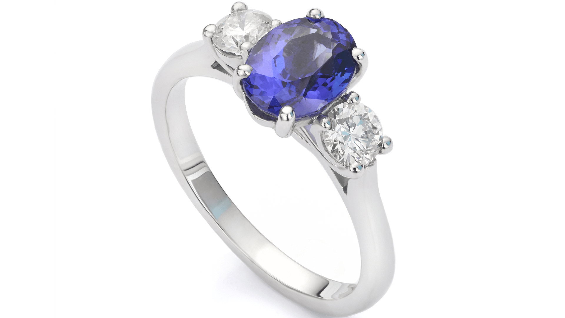 a ring studded with a blue sapphire and two diamonds