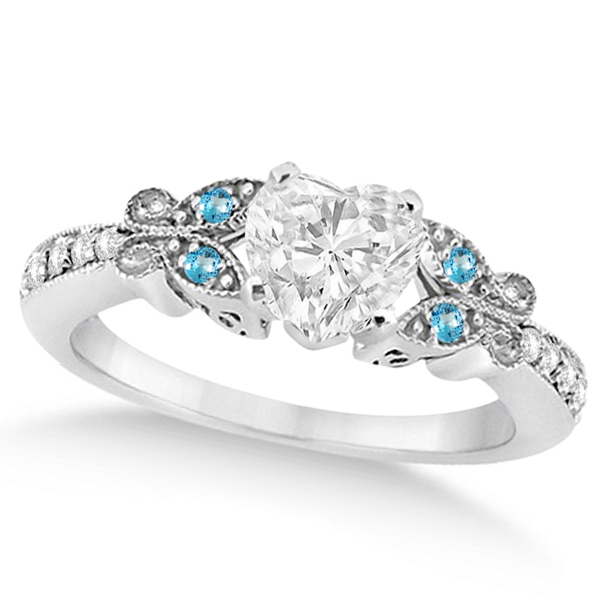 Make her feel special with this heart-cut butterfly design diamond & blue topaz engagement ring in 14k white gold . Purchase fine jewelry and diamonds at Allure