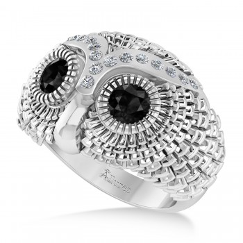 Men's Owl Diamond & Black Diamond Fashion Ring 14k White Gold (0.74ct) Try on some class with our mens owl diamond and black diamond fashion ring.This ring features a 14k white gold construction, a wide band and an even wider bezel. Mounted to the brow of the owl shaped bezel are 16 brilliant round diamonds. The diamonds flank a duet of black diamond that form the eyes of the owl. The diamonds total 0.74ct in weight, and are of G-H color and SI1-SI2 clarity. The stones are black and eye clean. This ring will let any man shine.This ring, like most jewelry here all Allurez, is available in a variety of precious metal options. Contact us for more information.