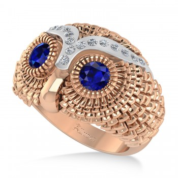 Men's Owl Diamond & Blue Sapphire Accented Fashion Ring 14k Rose Gold (0.74ct) Try on some class with our mens owl diamond and blue sapphire fashion ring.This ring features a 14k rose gold construction, a wide band and an even wider bezel. Mounted to the brow of the owl shaped bezel are 16 brilliant round diamonds. The diamonds flank a duet of blue sapphire that form the eyes of the owl. The diamonds total 0.74ct in weight, and are of G-H color and SI1-SI2 clarity. The stones are blue and eye clean. This ring will let any man shine.This ring, like most jewelry here all Allurez, is available in a variety of precious metal options. Contact us for more information.