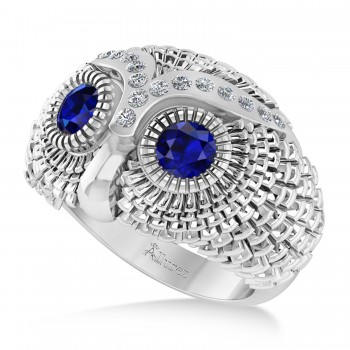 Men's Owl Diamond & Blue Sapphire Accented Fashion Ring 14k White Gold (0.74ct) Try on some class with our mens owl diamond and blue sapphire fashion ring.This ring features a 14k white gold construction, a wide band and an even wider bezel. Mounted to the brow of the owl shaped bezel are 16 brilliant round diamonds. The diamonds flank a duet of blue sapphire that form the eyes of the owl. The diamonds total 0.74ct in weight, and are of G-H color and SI1-SI2 clarity. The stones are blue and eye clean. This ring will let any man shine.This ring, like most jewelry here all Allurez, is available in a variety of precious metal options. Contact us for more information.