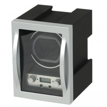 WOLF Module Men's Watch Winder w/ Customizable Winding Programs Here's a WOLF single watch winder with a modern design, space-age look and sophisticated customizable winding programs.With a glass cover and durable aerospace grade aluminum construction, this watch winder box is a perfect gift for the tech savvy watch collector.This winder's modular design makes it perfect for stacking and winding multiple watches separately.Measuring 4.5 inches wide X 6 inches deep x 6 inches high, this watch winder has a lock-in cuff that accommodates a wrist size up to 9 inches. This sleek watch winder runs on 110-220V AC power and includes a 5V adapter.This unit includes a connector piece and one bridal cable but requires additional accessories for stacking multiple units. Call for additional accessory pricing.