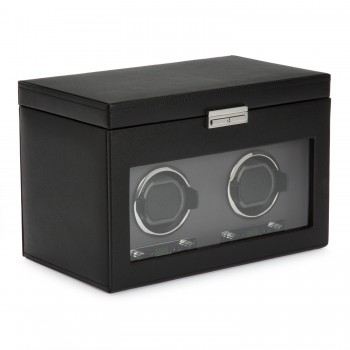 WOLF Viceroy Men's Double Watch Winder 4 Timepiece Storage Faux Leather Glass Door Here's a WOLF double watch winder that's sure to delight the watch aficionado.This double watch winder features patented rotation programs with a range of customizable turns per day, direction options to wind up to 2 automatic watches simultaneously. This watch winder also comes with a top storage compartment featuring 3 watch pillows and a convenient removable travel watch case to carry along 1 additional watch.Constructed with a sturdy wooden frame, this double watch winder and watch box is aesthetically crafted with a black pebble textured faux leather exterior, silver textured silk faceplate, a tempered glass cover, chrome accents and a key lock closure. It also features a lock-in cuff that accommodates even the larger watch in your collection.Measuring 13 inches wide x 8 inches deep x 9 inches high, this double watch winder runs on AC power with a 3.3V adapter (included) or 2 D-cell batteries (not included). This is that perfect gift to consider for the watch collector in your life that he'll be thankful for years to come.