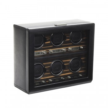 WOLF Roadster Men's 6 Watch Winder in Faux Leather w/ Wood Veneer, Glass & Key Lock This WOLF watch winder is a unique confluence of style and function.This exquisitely designed watch winder features a handcrafted wooded frame, an exotic Ebony Macassar wood veneer, a black pebble textured finish, glass cover, a backlit LCD display, and chrome control panels.This watch winder features patented rotation programs to take care of winding specifications of most automatic watches and a chrome key lock closure makes it a perfect display and storage option for up to 6 watches.The new lock-in cuff allows winding your larger watches with wrist sizes in excess of 10 inches. This 6 piece watch winder measures 15.75 inches wide x 6.5 inches deep x 13 inches high and operates exclusively on 110-220V AC power with the 3.3V adapter that comes with it.