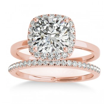Cushion Diamond Halo Bridal Set 18k Rose Gold (0.29ct) Including 43 awe-inspiring sidestones of SI1-SI2 clarity and G-H color totaling an impressive .29 carat weight, this Allurez 18k rose gold bridal set is sure to turn heads. Combining the best of both worlds, this cushion cut diamond blends an exciting mixture of the square cut with rounded corners, creating the soft visual effect of a glistening pillow. The possibilities for customization are truly endless as we at Allurez offer personal engraving and choice of center stone.  All Allurez rings come with the option of official appraisal to ensure optimum value. Allurez universally acclaimed craftsmanship comes second to none; promise her eternity in true luxury with an Allurez diamond bridal set today!