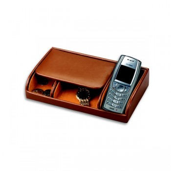 Men's Pigskin Lined Genuine Leather Dresser Valet  w/ Cell Phone Slot This genuine brown leather men's valet helps you keep your jewelry and cell phone safe and within reach.This brown genuine leather men's dresser valet features a slot for your cell phone, as well as a place for change, jewelry and other small items like keys and rings.This lovely pigskin lined valet is the perfect gift for any man who is looking for a bit more organization in their life. Personalize it with a custom monogram