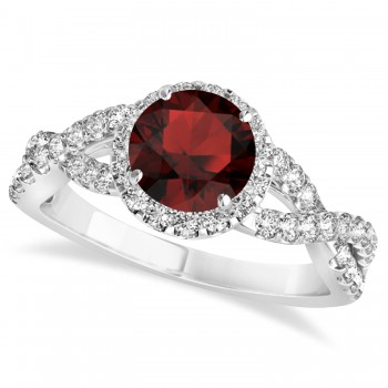 Garnet & Diamond Twisted Engagement Ring 14k White Gold 1.50ct A twist on the ordinary engagement ring, this infinity style, twisted garnet & diamond ring is sure to delight.Set in 14k white gold, this preset garnet & diamond engagement ring features a hand chosen center stone as well as stunning side stones accenting the halo and the infinity ring's shank.Sharing the fire and light of about one and half carats of conflict free diamonds, this garnet & diamond infinity halo engagement ring is filled with brilliant promise.