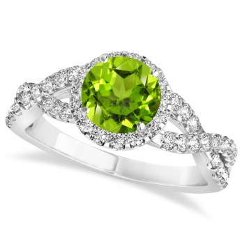 Peridot & Diamond Twisted Engagement Ring 14k White Gold 1.35ct A twist on the ordinary engagement ring, this infinity style, twisted peridot & diamond ring is sure to delight.Set in 14k white gold, this preset peridot & diamond engagement ring features a hand chosen center stone as well as stunning side stones accenting the halo and the infinity ring's shank.Sharing the fire and light of about one and half carats of conflict free diamonds, this peridot & diamond infinity halo engagement ring is filled with brilliant promise.