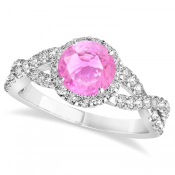 Pink Sapphire & Diamond Twisted Engagement Ring 14k White Gold 1.55ct A twist on the ordinary engagement ring, this infinity style, twisted pink sapphire & diamond ring is sure to delight.Set in 14k white gold, this preset pink sapphire & diamond engagement ring features a hand chosen center stone as well as stunning side stones accenting the halo and the infinity ring's shank.Sharing the fire and light of about one and half carats of conflict free diamonds, this pink sapphire & diamond infinity halo engagement ring is filled with brilliant promise.