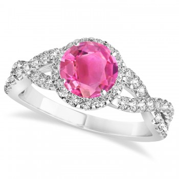 Pink Tourmaline & Diamond Twisted Engagement Ring 14k White Gold 1.25ct A twist on the ordinary engagement ring, this infinity style, twisted pink tourmaline & diamond ring is sure to delight.Set in 14k white gold, this preset pink tourmaline & diamond engagement ring features a hand chosen center stone as well as stunning side stones accenting the halo and the infinity ring's shank.Sharing the fire and light of about one and half carats of conflict free diamonds, this pink tourmaline & diamond infinity halo engagement ring is filled with brilliant promise.