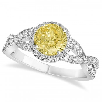 Yellow Diamond & Diamond Twisted Engagement Ring 14k White Gold 1.30ct A twist on the ordinary engagement ring, this infinity style, twisted yellow diamond & diamond ring is sure to delight.Set in 14k white gold, this preset yellow diamond & diamond engagement ring features a hand chosen center stone as well as stunning side stones accenting the halo and the infinity ring's shank.Sharing the fire and light of about one and half carats of conflict free diamonds, this yellow diamond & diamond infinity halo engagement ring is filled with brilliant promise.