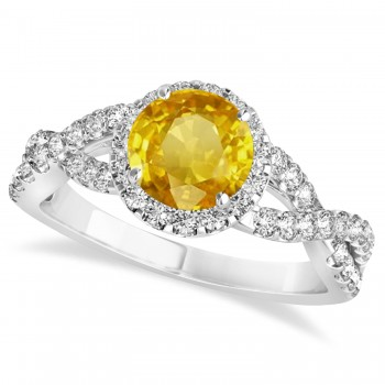 Yellow Sapphire & Diamond Twisted Engagement Ring 14k White Gold 1.55ct A twist on the ordinary engagement ring, this infinity style, twisted yellow sapphire & diamond ring is sure to delight.Set in 14k white gold, this preset yellow sapphire & diamond engagement ring features a hand chosen center stone as well as stunning side stones accenting the halo and the infinity ring's shank.Sharing the fire and light of about one and half carats of conflict free diamonds, this yellow sapphire & diamond infinity halo engagement ring is filled with brilliant promise.