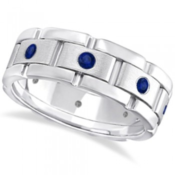 Men's Blue Sapphire Wedding Ring Wide Band 18k White Gold (0.80ct) When it comes to wedding bands for men ordinary just won't do, not when you can wear an extraordinary men's sapphire eternity wedding band. This wide grooms ring has eight round sapphires in a contemporary burnish setting, leaving each brilliant blue sapphire well secured in a unique rubbed 18K white gold edging. 0.80ct of blue sapphires adorn this men's wedding band with sophistication, giving it a modern edgy appearance. This men's sapphire band can also be worn as an anniversary or right hand ring. Sapphire is the birthstone for those born in the month of September.