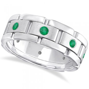 Men's Emerald Wedding Ring Wide Eternity Band Palladium (0.80ct) When it comes to wedding bands for men why settle for ordinary when you can have an extraordinary men's emerald wedding band. This wide grooms ring has eight round natural emeralds in a contemporary burnish setting, leaving each brilliant green emerald well secured in a unique rubbed palladium edge. 0.80ct of green emeralds adorn this men's eternity wedding band with sophistication, giving it a modern edgy appearance.This beautiful gemstone ring can also be worn as a fashion or anniversary ring, or as a birthstone ring for those born in May.