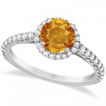 Halo Citrine & Diamond Engagement Ring  14K White Gold 1.60ct This preset engagement ring runs circles around an ordinary proposal band with a halo of diamonds framing a stunning center stone.Approximately 1.60ctw of dazzle make this the ring dreams are made of with 38 ideal cut diamonds creating stunning accents for a lovely round citrine center.The 1.10 carat center citrine is elegantly accented by 0.50ctw of sparkling diamonds, dancing around the center. This beautiful halo engagement ring can also be worn as a fashion ring and anniversary ring.