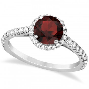 Halo Garnet & Diamond Engagement Ring  14K White Gold 1.90ct This preset engagement ring runs circles around an ordinary proposal band with a halo of diamonds framing a stunning center stone.Approximately 1.90ctw of dazzle make this the ring dreams are made of with 38 ideal cut diamonds creating stunning accents for a lovely round garnet center.The 1.40 carat center garnet is elegantly accented by 0.50ctw of sparkling diamonds, dancing around the center. This beautiful halo engagement ring can also be worn as a fashion ring and anniversary ring.