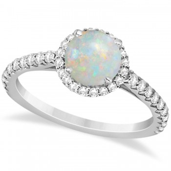Halo Opal & Diamond Engagement Ring  14K White Gold 1.25ct This preset engagement ring runs circles around an ordinary proposal band with a halo of diamonds framing a stunning center stone.Approximately 1.25ctw of dazzle make this the ring dreams are made of with 38 ideal cut diamonds creating stunning accents for a lovely round opal center.The 0.75 carat center opal is elegantly accented by 0.50ctw of sparkling diamonds, dancing around the center. This beautiful halo engagement ring can also be worn as a fashion ring and anniversary ring.