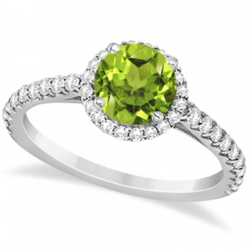 Halo Peridot & Diamond Engagement Ring  14K White Gold 1.61ct This preset engagement ring runs circles around an ordinary proposal band with a halo of diamonds framing a stunning center stone.Approximately 1.61ctw of dazzle make this the ring dreams are made of with 38 ideal cut diamonds creating stunning accents for a lovely round peridot center.The 1.11 carat center peridot is elegantly accented by 0.50ctw of sparkling diamonds, dancing around the center. This beautiful halo engagement ring can also be worn as a fashion ring and anniversary ring.