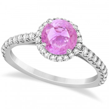 Halo Pink Sapphire & Diamond Engagement Ring  14K White Gold 1.91ct This preset engagement ring runs circles around an ordinary proposal band with a halo of diamonds framing a stunning center stone.Approximately 1.91ctw of dazzle make this the ring dreams are made of with 38 ideal cut diamonds creating stunning accents for a lovely round pink sapphire center.The 1.41 carat center pink sapphire is elegantly accented by 0.50ctw of sparkling diamonds, dancing around the center. This beautiful halo engagement ring can also be worn as a fashion ring and anniversary ring.
