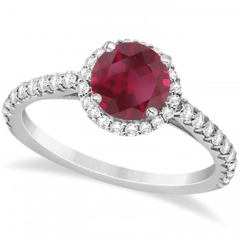 Halo Ruby & Diamond Engagement Ring  14K White Gold 1.91ct This preset engagement ring runs circles around an ordinary proposal band with a halo of diamonds framing a stunning center stone.Approximately 1.91ctw of dazzle make this the ring dreams are made of with 38 ideal cut diamonds creating stunning accents for a lovely round ruby center.The 1.41 carat center ruby is elegantly accented by 0.50ctw of sparkling diamonds, dancing around the center. This beautiful halo engagement ring can also be worn as a fashion ring and anniversary ring.