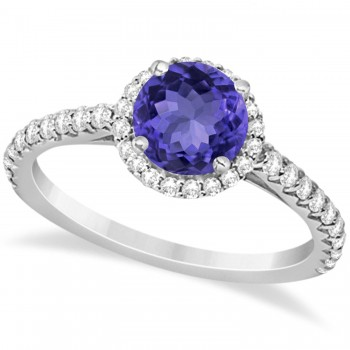 Halo Tanzanite & Diamond Engagement Ring  14K White Gold 1.60ct This preset engagement ring runs circles around an ordinary proposal band with a halo of diamonds framing a stunning center stone.Approximately 1.60ctw of dazzle make this the ring dreams are made of with 38 ideal cut diamonds creating stunning accents for a lovely round tanzanite center.The 1.10 carat center tanzanite is elegantly accented by 0.50ctw of sparkling diamonds, dancing around the center. This beautiful halo engagement ring can also be worn as a fashion ring and anniversary ring.