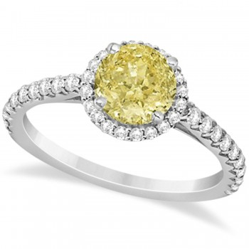 Halo Yellow Diamond & Diamond Engagement Ring  14K White Gold 1.50ct This preset engagement ring runs circles around an ordinary proposal band with a halo of diamonds framing a stunning center stone.Approximately 1.50ctw of dazzle make this the ring dreams are made of with 38 ideal cut diamonds creating stunning accents for a lovely round yellow diamond center.The one carat center yellow diamond is elegantly accented by 0.50ctw of sparkling diamonds, dancing around the center. This beautiful halo engagement ring can also be worn as a fashion ring and anniversary ring.