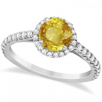 Halo Yellow Sapphire & Diamond Engagement Ring  14K White Gold 1.91ct This preset engagement ring runs circles around an ordinary proposal band with a halo of diamonds framing a stunning center stone.Approximately 1.91ctw of dazzle make this the ring dreams are made of with 38 ideal cut diamonds creating stunning accents for a lovely round yellow sapphire center.The 1.41 carat center yellow sapphire is elegantly accented by 0.50ctw of sparkling diamonds, dancing around the center. This beautiful halo engagement ring can also be worn as a fashion ring and anniversary ring.