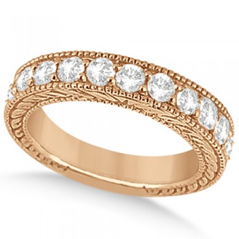 Antique Diamond Engagement Wedding Ring Band 14k Rose Gold (1.10ct) Crafted in 14kt Rose Gold (Pink Gold), this vintage style diamond wedding ring showcases 11 diamonds. The brilliant cut round diamonds total 1.10 carat.The diamonds are of clear G-H Color, VS2-SI1 Clarity and are set in a bead setting.The heirloom wedding band features filigree (scroll work) and milgrained edge engravings.This unique bridal wedding ring is available in other metals.