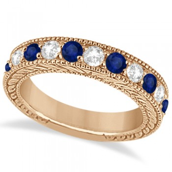 Antique Diamond & Sapphire Wedding Ring Band 14k Rose Gold (1.46ct) Hand crafted in 14kt rose gold (otherwise known as pink gold), this vintage style diamond wedding ring showcases 11 round cut stones for a total  of 1.46 carats.The 5 diamonds are of clear G-H color and VS2-SI1 clarity & alternate with six beautiful eye clean blue sapphires, all mounted in a bead setting.The art deco wedding band features filigree (scroll work) and milgrained edge engravings for a classic look that never goes out of style.This one-of-a-kind bridal wedding ring is available in alternate metals as well.