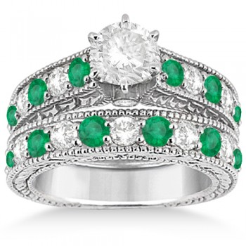 Antique Diamond & Emerald Bridal Wedding Ring Set Platinum (2.51ct) This platinum diamond & emerald engagement ring with matching wedding band displays a total of 23 bead set gemstones. The clear white diamonds are of G-H Color and VS2-SI1 Clarity, and alternate with beautiful round-cut green emeralds.Completed with milgrained edges and scroll work, the matching set has a unique style that evokes both the past and present. Design your own engagement ring with a center stone of your choice carat weight and shape that fits into the central prong mounting's interchangeable head.This vintage bridal ring set is available in other metals.