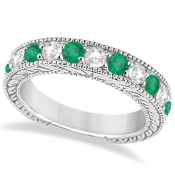 Antique Diamond & Emerald Wedding Ring Band 18k White Gold (1.28ct) This heirloom diamond wedding ring is expertly crafted in 18kt white gold, showcasing hand-set diamonds and emeralds, milgrain edges, and scroll work (filigree).The antique-style ring features 11 brilliant-cut round stones: six bold emeralds alternate with five diamonds of clear G-H color and VS2-SI1 clarity for stunning effect.The stones are mounted in a bead setting and total 1.28ct.This designer bridal wedding band is also available in other metals.