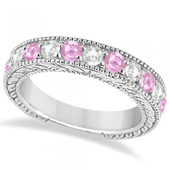 Antique Diamond & Pink Sapphire Wedding Ring 18k White Gold (1.46ct) This heirloom diamond wedding ring is expertly crafted in 18kt white gold, showcasing hand-set diamonds and pink sapphires, milgrain edges, and scroll work (filigree).The antique-style ring features 11 brilliant-cut round stones: six bold pink sapphires alternate with five diamonds of clear G-H color and VS2-SI1 clarity for stunning effect.The stones are mounted in a bead setting and total 1.46ct.This designer bridal wedding band is also available in other metals.