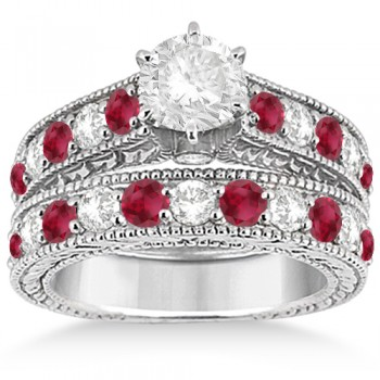 Antique Diamond & Ruby Wedding & Engagement Ring Set Platinum (2.75ct) This platinum diamond & ruby engagement ring with matching wedding band displays a total of 23 bead set gemstones. The clear white diamonds are of G-H Color and VS2-SI1 Clarity, and alternate with beautiful round-cut red rubies.Completed with milgrained edges and scroll work, the matching set has a unique style that evokes both the past and present. Design your own engagement ring with a center stone of your choice carat weight and shape that fits into the central prong mounting's interchangeable head.This vintage bridal ring set is available in other metals.