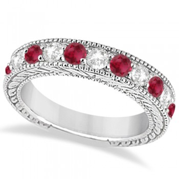 Antique Diamond & Ruby Engagement Wedding Ring 18k White Gold (1.40ct) This heirloom diamond wedding ring is expertly crafted in 18kt white gold, showcasing hand-set diamonds and rubies, milgrain edges, and scroll work (filigree).The antique-style ring features 11 brilliant-cut round stones: six bold rubies alternate with five diamonds of clear G-H color and VS2-SI1 clarity for stunning effect.The stones are mounted in a bead setting and total 1.40ct.This designer bridal wedding band is also available in other metals.