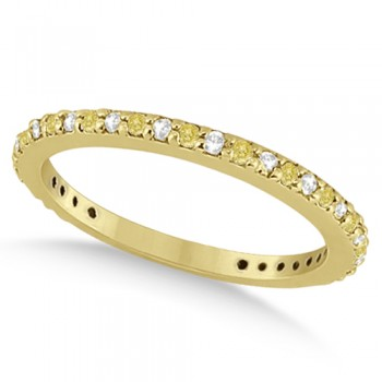Eternity White & Yellow Diamond Wedding Band in 14K Yellow Gold 0.54ct This unique white and yellow diamond eternity wedding band features 27 round cut diamonds set in a 14K  yellow gold pave setting. The diamonds on this eternity style wedding ring go nearly all the way around except for a small shank for resizing.This unusual wedding ring has a petite band for smaller fingers.The white and fancy  yellow diamond ring can be worn as an anniversary ring, right hand fashion ring, or paired with a matching white and yellow engagement ring.