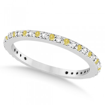 Eternity White & Yellow Diamond Wedding Band in Palladium 0.54ct This unique white and yellow diamond eternity wedding band features 27 round cut diamonds set in a palladium pave setting. The diamonds on this eternity style wedding ring go nearly all the way around except for a small shank for resizing.This unusual wedding ring has a petite band for smaller fingers.The white and fancy  yellow diamond ring can be worn as an anniversary ring, right hand fashion ring, or paired with a matching white and yellow engagement ring.