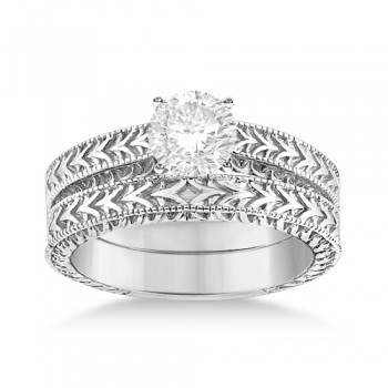 Solitaire Engagement Ring & Wedding Band Bridal Set 18k White Gold This fancy carved vintage solitaire engagement ring with matching band features antique style scroll work and milgrained edges. The antique designer bridal set comes in an elegant 18kt White Gold setting.Choose a diamond of your choice carat weight and shape in order to design your own engagement ring.This unique hand engraved heirloom matching set is made in the USA like all our other fine jewelry items and is also available in other precious metals.