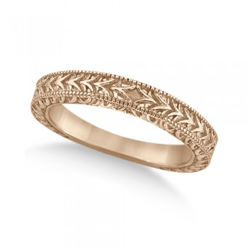Antique Engraved Wedding Band w/ Filigree & Milgrain 18k Rose Gold This heirloom style carved wedding band features fancy scroll work design and milgrained edges. The hand engraved bridal ring is crafted in 18kt Rose Gold.This unique designer vintage ring is made in the USA like all our other fine jewelry items and is also available in other precious metals.Wear it as an anniversary ring or a right hand fashion ring.