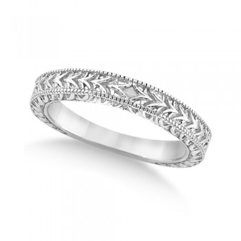 Antique Engraved Wedding Band w/ Filigree & Milgrain 18k White Gold This heirloom style carved wedding band features fancy scroll work design and milgrained edges. The hand engraved bridal ring is crafted in 18kt White Gold.This unique designer vintage ring is made in the USA like all our other fine jewelry items and is also available in other precious metals.Wear it as an anniversary ring or a right hand fashion ring.