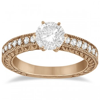 Vintage Style Diamond Filigree Engagement Ring 18k Rose Gold (0.16ct) This milgrain edge proposal ring setting can fit any size and cut diamond as the center stone. The diamonds are a total 0.16 carat weight, and holds 19 brilliant diamonds with VS2-SI1 clarity and G-H color. The pave 18k rose gold (pink gold) setting crafts the diamonds into a breathtaking semi-eternity design.  This antique carved engagement ring setting is also available with a matching wedding band for the big day.