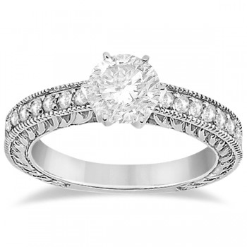 Vintage Style Diamond Filigree Engagement Ring Platinum (0.16ct) This milgrain edge proposal ring setting can fit any size and cut diamond as the center stone. The diamonds are a total 0.16 carat weight, and holds 19 brilliant diamonds with VS2-SI1 clarity and G-H color. The pave platinum setting crafts the diamonds into a breathtaking semi-eternity design.  This antique carved engagement ring setting is also available with a matching wedding band for the big day.
