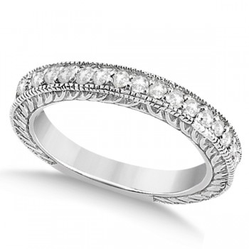 Vintage Style Filigree Diamond Wedding Band 14k White Gold (0.19ct) This outstanding diamond milgrain edge wedding ring can be worn with our Vintage Style Filigree Diamond Ring Setting or on its own for a beautiful bridal accessory. This bridal band is a total of 0.19 carat diamond. The 19 brilliant cut diamonds shine with VS2-SI1 clarity and G-H color.  These round diamonds are created in a unique antique carved pave 14k white gold ring, making an old look with a modern spin .
