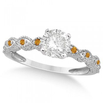Vintage Diamond & Citrine Engagement Ring 18k White Gold 1.50ct Dazzle her with this vintage style diamond and citrine engagement ring, preset with approximately 1.50 total carats of expertly chosen gems.This ring, proudly made in the USA, features a prong set conflict free round diamond of approximately 1.30 carats with eight pave set citrine side stone accents. These side stone feature an approximate total weight of 0.18 additional carats.This stunning antique setting of 18k white gold makes this diamond and citrine twisted shank engagement ring the perfect choice for those brides looking for an alternative to the ordinary diamond ring.