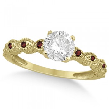 Vintage Diamond & Garnet Engagement Ring 18k Yellow Gold 1.50ct Dazzle her with this vintage style diamond and garnet engagement ring, preset with approximately 1.50 total carats of expertly chosen gems.This ring, proudly made in the USA, features a prong set conflict free round diamond of approximately 1.30 carats with eight pave set garnet side stone accents. These side stone feature an approximate total weight of 0.18 additional carats.This stunning antique setting of 18k yellow gold makes this diamond and garnet twisted shank engagement ring the perfect choice for those brides looking for an alternative to the ordinary diamond ring.