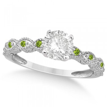 Vintage Diamond & Peridot Engagement Ring 18k White Gold 1.50ct Dazzle her with this vintage style diamond and peridot engagement ring, preset with approximately 1.50 total carats of expertly chosen gems.This ring, proudly made in the USA, features a prong set conflict free round diamond of approximately 1.30 carats with eight pave set peridot side stone accents. These side stone feature an approximate total weight of 0.18 additional carats.This stunning antique setting of 18k white gold makes this diamond and peridot twisted shank engagement ring the perfect choice for those brides looking for an alternative to the ordinary diamond ring.