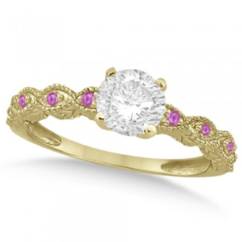 Vintage Diamond & Pink Sapphire Engagement Ring 18k Yellow Gold 1.50ct Dazzle her with this vintage style diamond and pink sapphire engagement ring, preset with approximately 1.50 total carats of expertly chosen gems.This ring, proudly made in the USA, features a prong set conflict free round diamond of approximately 1.30 carats with eight pave set pink sapphire side stone accents. These side stone feature an approximate total weight of 0.18 additional carats.This stunning antique setting of 18k yellow gold makes this diamond and pink sapphire twisted shank engagement ring the perfect choice for those brides looking for an alternative to the ordinary diamond ring.