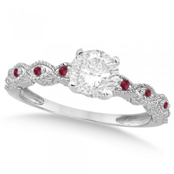 Vintage Diamond & Ruby Engagement Ring 18k White Gold 1.50ct Dazzle her with this vintage style diamond and ruby engagement ring, preset with approximately 1.50 total carats of expertly chosen gems.This ring, proudly made in the USA, features a prong set conflict free round diamond of approximately 1.30 carats with eight pave set ruby side stone accents. These side stone feature an approximate total weight of 0.18 additional carats.This stunning antique setting of 18k white gold makes this diamond and ruby twisted shank engagement ring the perfect choice for those brides looking for an alternative to the ordinary diamond ring.