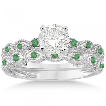Antique Emerald Engagement Ring & Wedding Band 18k White Gold (0.36ct) A total of 16 emeralds set in a pave setting form a contemporary 18kt White Gold non-diamond engagement ring with matching wedding band. The fancy designer bridal set has bright red brilliant cut rubies.The hand-set gemstones on this antique carved ring sit within marquise shaped patterns on a milgrained edge band. The band has scroll work on either side of the center prong mounting. Design your own engagement ring with a center stone that can be set into the prong mounting.This antique style bridal set is also available in other metals and different colored gemstones.
