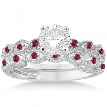 Antique Ruby Engagement Ring and Wedding Band 18k White Gold (0.36ct) A total of 16 rubies set in a pave setting form a contemporary 18kt White Gold non-diamond engagement ring with matching wedding band. The fancy designer bridal set has bright red brilliant cut rubies.The hand-set gemstones on this antique carved ring sit within marquise shaped patterns on a milgrained edge band. The band has scroll work on either side of the center prong mounting. Design your own engagement ring with a center stone that can be set into the prong mounting.This antique style bridal set is also available in other metals and different colored gemstones.